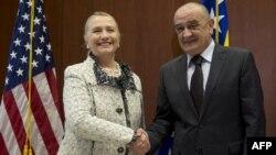 Bosnian Prime Minister Vjekoslav Bevanda (right) greets U.S. Secretary of State Hillary Clinton at the U.S. Embassy in Sarajevo.