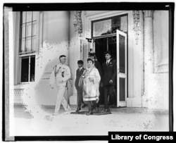 Fatima leaves the White House with her three sons and an unidentified naval officer after meeting with President Harding. The U.S. Library of Congress photo caption incorrectly identifies the official as Weyman/Weinberg.