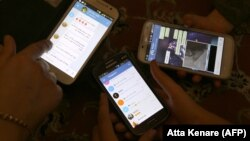 Iranians display their smart phones using the Telegram messenger application. File photo
