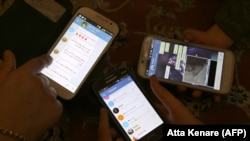 IRAN -- Iranians display their smart phones using the Telegram messenger application, December 1, 2015