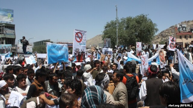 Supporters of Afghan presidential candidate Abdullah Abdullah demonstrate  in Kabul on June 21.