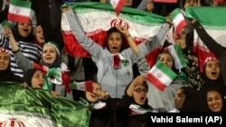 Iranian women cheer after authorities in a rare move allowed some women into the Azadi stadium to watch a soccer match in October 2018.