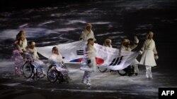 Түштүк Кореянын Пхёнчхаң шаарында дүйнөлүк 23-кышкы Олимпиада оюндары ачылышы. Эки Кореянын өкүлдөрү. 9-февраль, 2018-жыл.