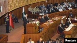 Chinese President Xi Jinping addresses a joint session of parliament in Islamabad on April 21.