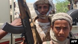 Forces loyal to Yemeni President Abu-Rabbu Mansur Hadi display their arms as they take part in an operation to drive Al-Qaeda fighters out of the capital of southern Abyan Province earlier this year.