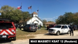 Police secure the site of a mass shooting in Sutherland Springs, Texas, on November 5.