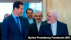 Президент Сирии Башар Асад (слева) и министр иностранных дел Ирана Мохаммад Джавад Зариф (справа). Дамаск, 16 апреля 2019 года.