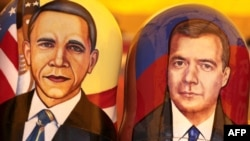 Likenesses of U.S. President Barack Obama (left) and his Russian counterpart, Dmitry Medvedev, on nesting dolls in Moscow