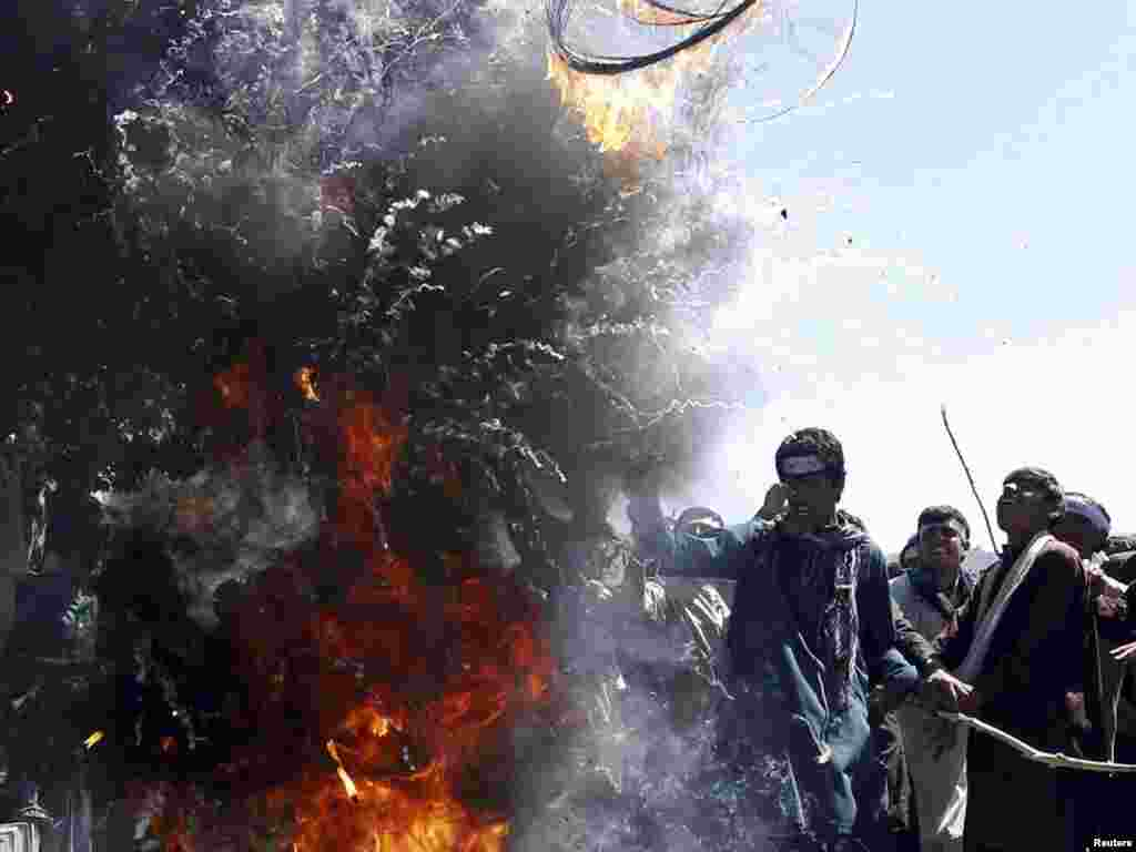 Afghans burn tires during a protest against the burning of a Koran supervised by Florida-based militant fundamentalist Christian preacher Terry Jones, on the Kabul-Jalalabad highway on April 5. Photo by Parwiz for Reuters