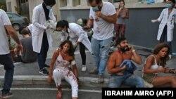 Получившие ранения люди в Бейруте. 4 августа 2020 года.