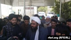 An angry crowd gathers outside Uruzgan's provincial health department in Tarin Kowt on September 26. Demonstrators also protested outside the province's main hospital in Tarin Kowt.