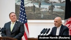 Afghan President Ashraf Ghani (right) and Secretary of State Mike Pompeo during a news conference at the Presidential Palace in Kabul in July.