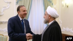 Hassan Rohani və Mohammed Jihad al-Laham