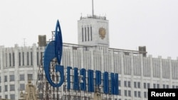 Russia -- The company logo of natural gas producer Gazprom is seen on an advertisement in front of the White House in Moscow, 08Feb2013