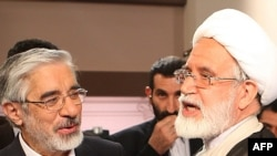 Former presidential candidates Mir Hossein Musavi (left) and Mehdi Karrubi have been out of sight for weeks.
