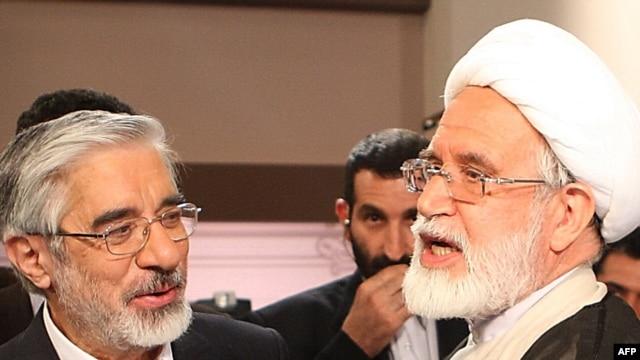 Mir Hossein Musavi (left) and Mehdi Karrubi
