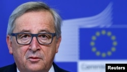 European Commission President Jean Claude Juncker says he is visiting Russia next month for dialogue, not to weaken sanctions.