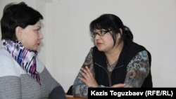 Kazakh journalist Guzyal Baidalinova (right) and her lawyer Inessa Kisileva confer in Almaly district court in December.