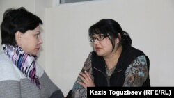 Kazakh journalist Guzyal Baidalinova (right) and lawyer Inessa Kisileva talk in Almaly district court in December.