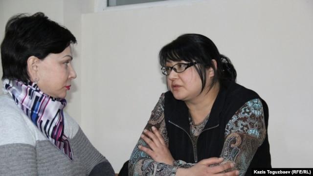 Kazakh journalist Guzyal Baidalinova (right) and lawyer Inessa Kisileva talk in Almaly district court in December.