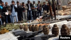 Weapons and ammunition seized from captured suspected Taliban are presented to the media at the National Directorate of Security (NDS) headquarters in Kabul on March 15.
