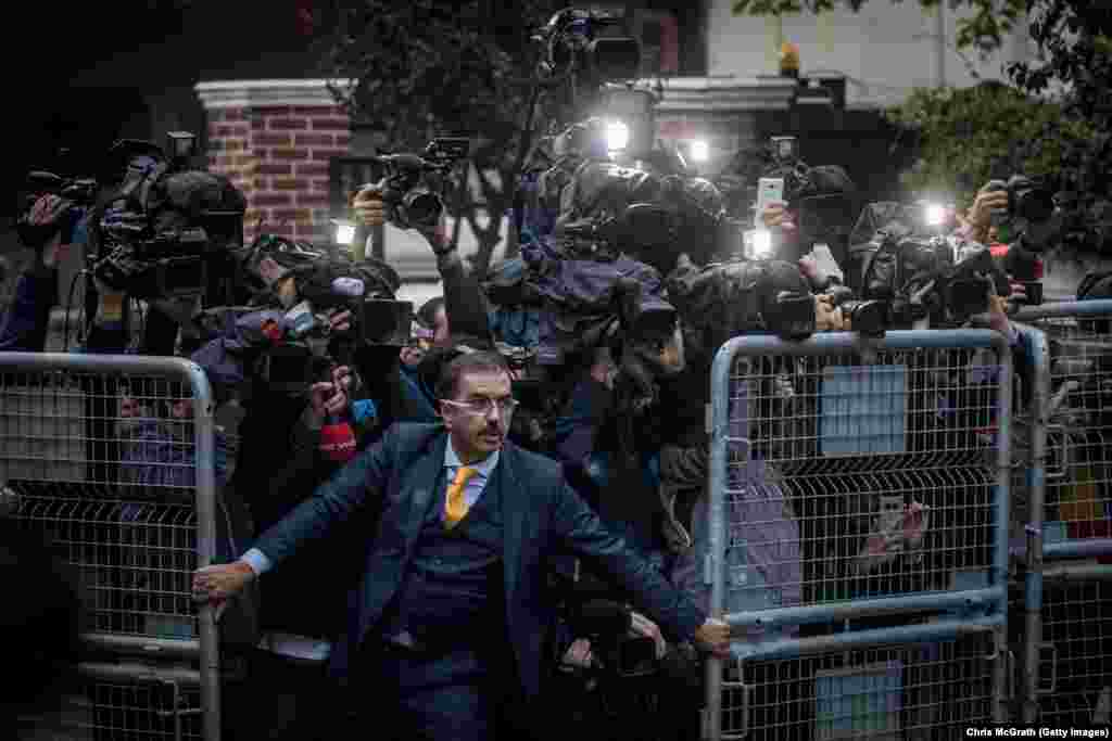 An unidentified man tries to hold back the press as investigators arrive at the Saudi Consulate in Istanbul, Turkey, amid the international backlash to the disappearance of journalist Jamal Khashoggi. Intelligence officials in the United States said they think Saudi Crown Prince Mohammed bin Salman ordered the killing of Khashoggi, a frequent critic of the royal family. Saudi officials have denied the claim. General News: First Prize, Singles - Chris McGrath, Getty Images