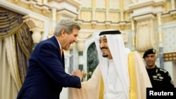 U.S. Secretary of State John Kerry (left) meets with Saudi Arabia's King Salman in Riyadh on May 7.