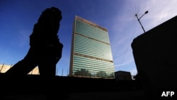 Policemen walk around the UN building in New York on September 21, 2009.