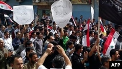 Syria -- Anti-government protesters march in the northeastern town of Qamishli, 01Apr2011