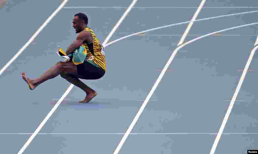 Usain Bolt of Jamaica performs a traditional Russian dance after Jamaica won the men's 4X100-meter relay final during the IAAF World Athletics Championships in Moscow. (Reuters/Phil Noble)