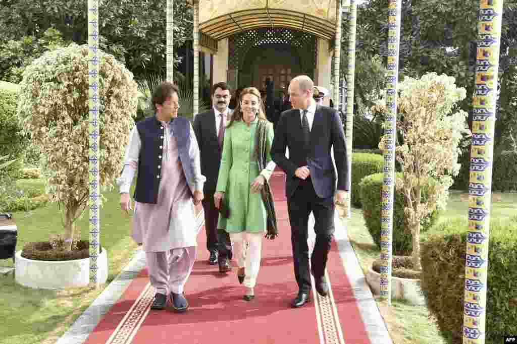 Pakistani Prime Minister Imran Khan (left) with Britain's Catherine, duchess of Cambridge, and Prince William, duke of Cambridge, in Islamabad on October 15.