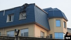 The roof of the Polish Consulate in Lutz was damaged overnight by an unidentified large-caliber weapon on March 29.