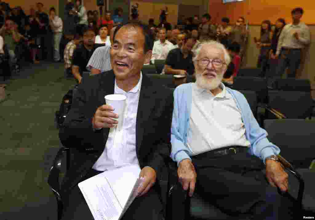 Japanese-born U.S. citizen Shuji Nakamura (left) laughs as he waits to speak at a news conference in California after winning the 2014 Nobel Prize for Physics. He is pictured with 2000 Nobel Prize for Physics winner Herbert Kroemer. Nakamura and two Japanese scientists -- Isamu Akasaki and Hiroshi Amano -- won the Nobel Prize for inventing a new energy-efficient and environmentally friendly light source, leading to the creation of modern LED light bulbs. (Reuters/Lucy Nicholson)