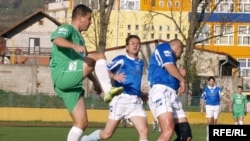 The imams, in green, took on a team of Catholic priests, in blue, in Tuzla's Tusanj stadium.