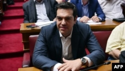 Greek Prime Minister Alexis Tsipras looks on during the Syriza party's parliamentary group meeting at the Greek parliament in Athens on July 15.
