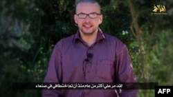 A video grab from a terrorist group's media arm shows U.S. hostage Luke Somers calling for help and saying his life is in danger.