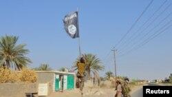 Архивска фотографија на ослободување на покраината Анбар од милитантите на ИД
