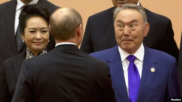 """'No statehood,' you say?!"" Kazakh President Nursultan Nazarbaev (right) reacts during a handshake with Russian President Vladimir Putin at a summit in Shanghai, China in late May."
