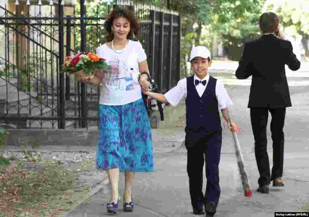 A young student sports formal wear in Almaty, Kazakhstan.