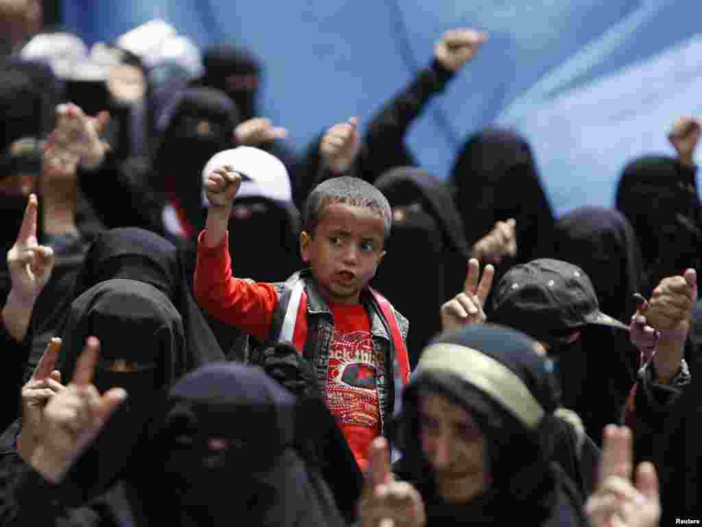 A boy and female antigovernment protesters shout slogans during a demonstration demanding the resignation of Yemen's President Ali Abdullah Saleh outside Sanaa University on March 29. Photo by Ammar Awad for Reuters