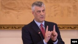 Kosovar President Hashim Thaci gestures during a press conference of his cabinet in Pristina on March 8, 2017.