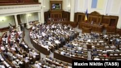 Ukrainian lawmakers passed the first reading of a controversial draft law on sanctions by a small majority on August 12.