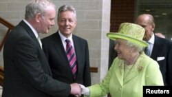 Queen Elizabeth greets Northern Ireland's deputy first minister, Martin McGuinness, in Belfast on June 27.