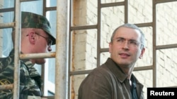 Jailed former oil magnate Mikhail Khodorkovsky (right) was unexpectedly released this week. (file photo)