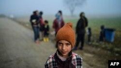 Një migrant në Idomeni, foto arkiv