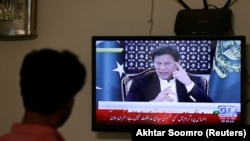 PAKISTAN -- A television screen displays Prime Minister of Pakistan Imran Khan, speaking about his plans with regards to COVID19. April 14, 2020.