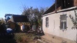 Astanada evlər dağıdılır