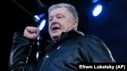 Former Ukrainian President and current lawmaker Petro Poroshenko speaks during a rally in central Kyiv on December 8, 2019.