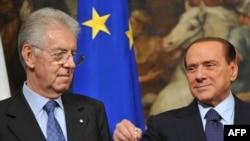 Новый премьер Италии Марио Монти и бывший премьер Сильвио Берлускони