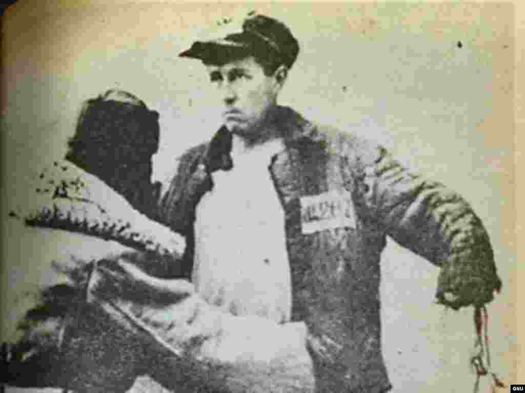Denounced as a traitor in 1945, Solzhenitsyn was sent to gulags in Russia and Kazakhstan for eight years. The photo shows Solzhenitsyn, prisoner #282, being searched in 1953. After three more years of internal exile in Kazakhstan, he returned to Russia to work as a schoolteacher.